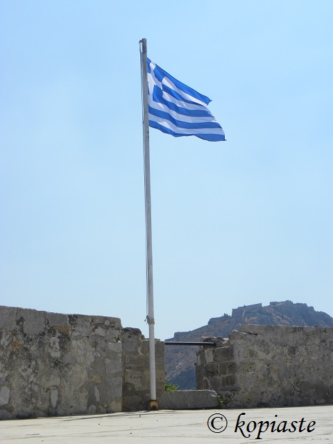 Greek flag on Bourji and view of Palamidi